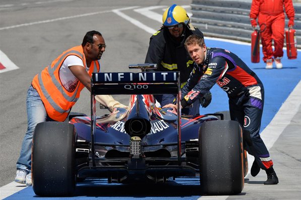 Sebastian Vettel pushes his car back to the garage after a malfunction on Day Three of the final testing weekend in Bahrain. Source: Formula1.com